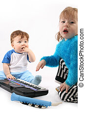 Duo - Small boy and Girl plays with the electronic piano.