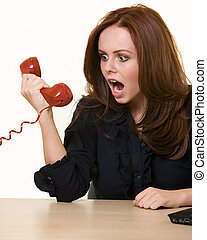 Yelling into the phone - Young brunette woman in business...