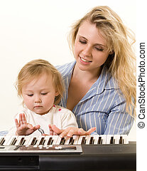 Learning to play keyboard - Portrait of an attractive young...