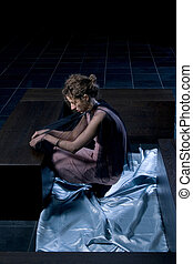 woman in a dark room