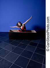 woman flying - girl sitting in a wooden box, flying
