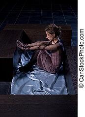 girl sitting in dark