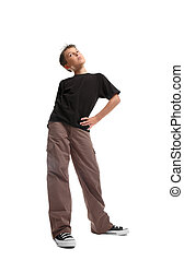 Standing boy ina plain black t-shirt and cargos. He is...