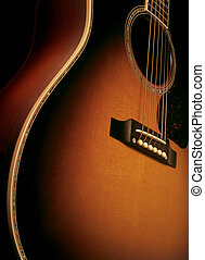 Acoustic guitar - Angle shot of a maple wood acoustic guitar...
