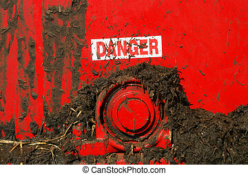 Muck spreader - Grunge danger sign