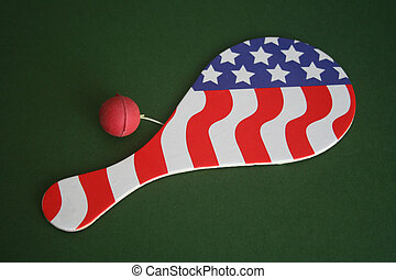 Paddle ball with the American flag over green background