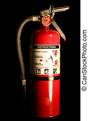 Fire Extinguisher - A red fire extinguisher on a black...