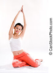 streching exercise - young woman with tank top and orange...