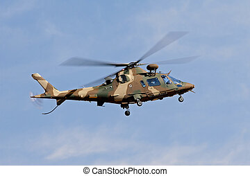 Military helicopter - A camouflaged military helicopter in...