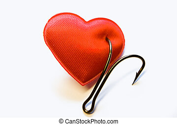 The red heart pinned on a fishing hook