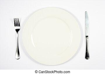 Dinner Setting - A place setting for dinner against white...