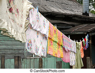 Bed-clothes - The bed-clothes to be dried on a cord in a...