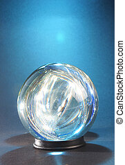 Lights within crystal ball against blue light - lights...