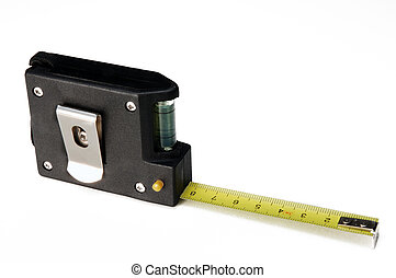 Measuring tape over a light background from above