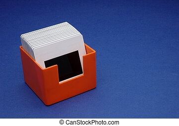 slide box - a orange slide box on blue background