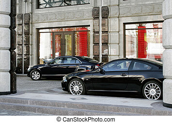 Two cars - Two modern cars business-class are parked beside...