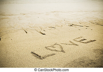 Love sign on the beach - A LOVE letter drawn on a sandy...
