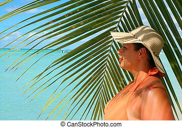 tropical beach woman - voluptuous woman with palm backdrop...
