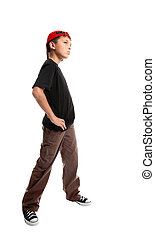 Youth standing pose - Youth in cargoes and t-shirt stands...