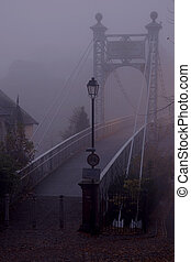 Bridge in the fog - Queens Park Footbridge in Chester UK...