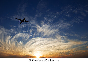 Sunset and airplane on Tel Aviv city from Israel