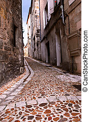 Medieval street in France - Narrow medieval street in town...