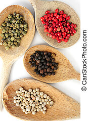 Assorted peppercorns - Four kinds of peppercorns in wooden...