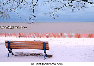 Winter bench - Winter park with a bench covered with snow...