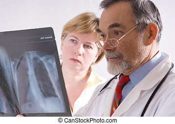 X-ray - Two doctors looking at an X-ray
