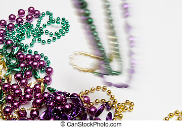 Mardi Gras - Throwing Mardi Gras beads. Some are in motion,...