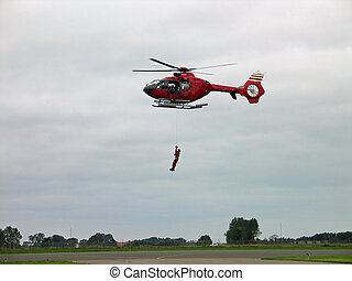 Helicopter rescue operation - Rescue team member dropping...