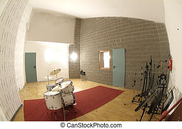 Musical instruments in studio with door and red carpet