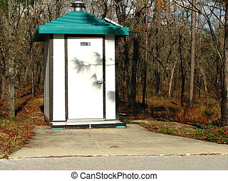 modern outhouse in forest