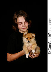 Boy and His Dog - Young Teen Boy Holding Pet Pomeranian