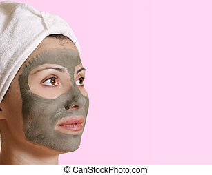 Female clay beauty mask - Female with a clay mask and space...