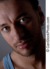 Portrait of a young adult man - Studio portrait of a young...