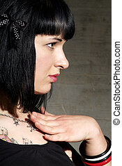 friendly woman - a woman with black hair and tattoo