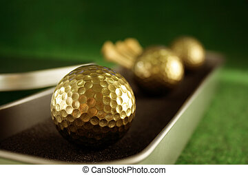 Golden golfballs in gift set for luxury play