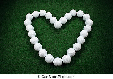 Valentine golf - Golfballs forming a heart for valentine or...