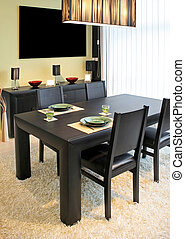 Dinning angle - Modern dinning room with black table and...