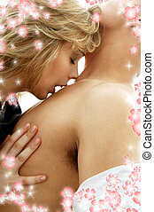 seduction with flowers - intimate color image of sensual...