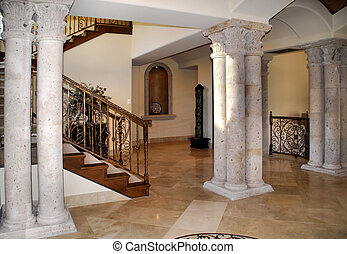 grand foyer - beautiful entrance to home with stone columns...