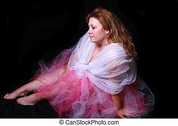 dancer taking a break - Beautiful woman siting down wearing...
