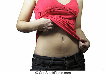 Girl and navel piercing - A girl in a red vest with a navel...