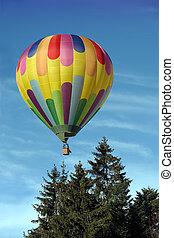Hot air balloon above - A vivid hot air balloon floating up...