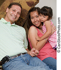 Happy family - Portrait of a mixed race family with Asian...