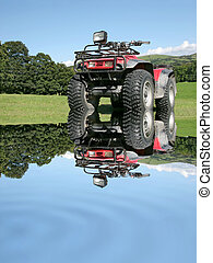 All Terrain Quad Bike - Red and black four wheel drive quad...