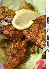 Chicken wings lemon pepper in a basket