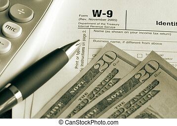 Tax time - W9 form with calculator and us currency