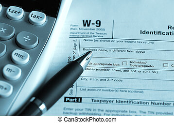 Tax time - W9 form with calculator and a pen in blue tint